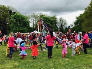 Plaistow Pre-School children dancing around the Maypole.